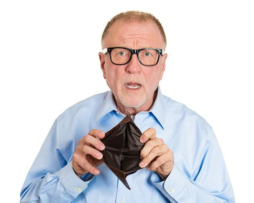 shocked senior man holding empty wallet
