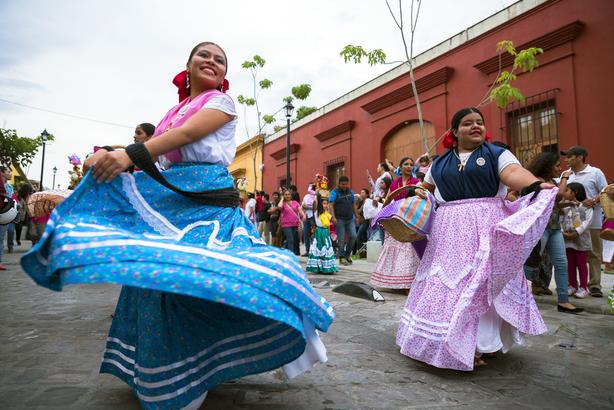 Oaxacan women dancing during a festival