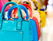 Row of brightly colored handbags