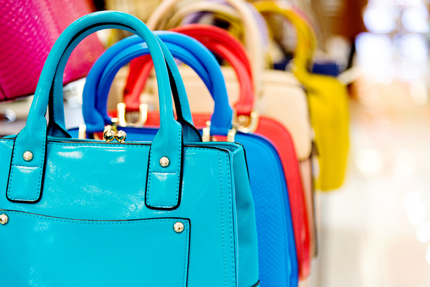 Row of brightly colored handbags