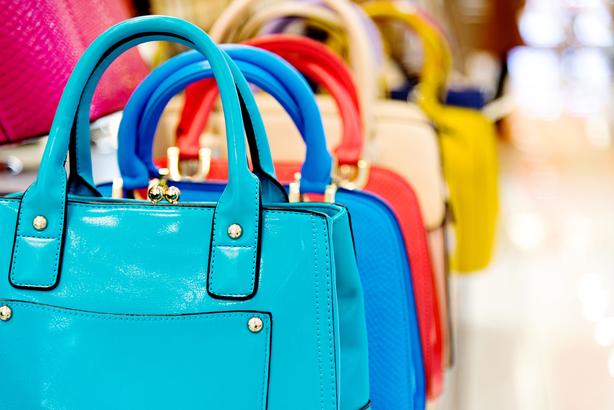 ea0c0b5b3fbd Row of brightly colored handbags
