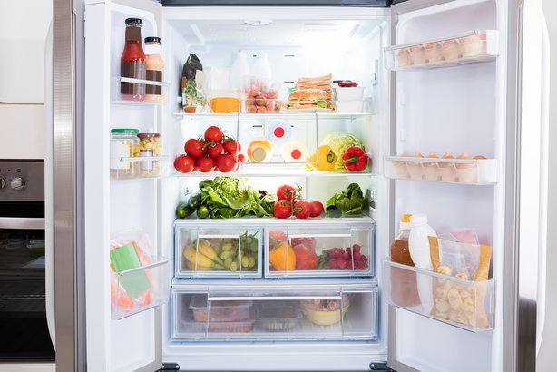 open refrigerator filled with fresh fruits and vegetable