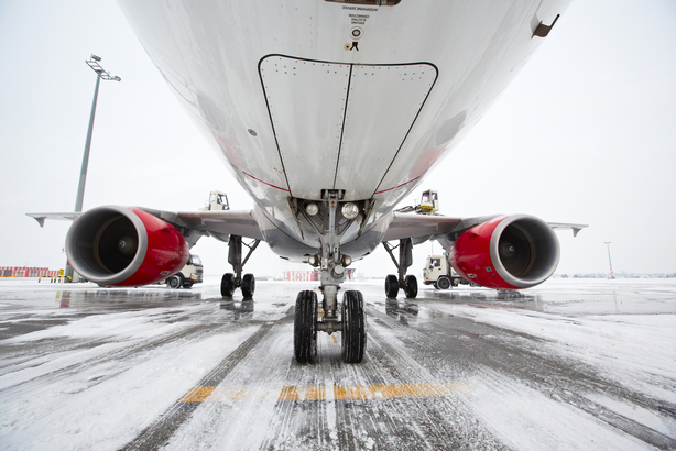Airplane on a runway in the snow