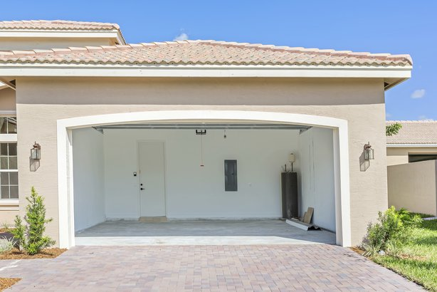 brand new house being built with an empty garage