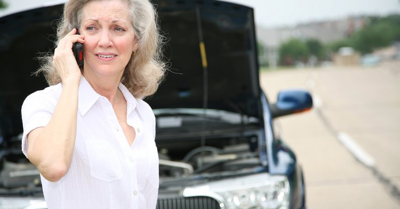 worried senior calling for help with her car
