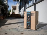 Amazon cardboard package delivery at front door