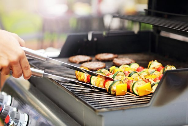 gas grill being prepared with food