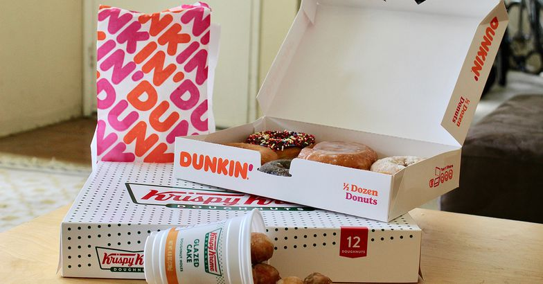 Krispy Kreme and Dunkin' Donuts doughnuts with boxes and bag