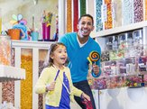 girl and father in candy store