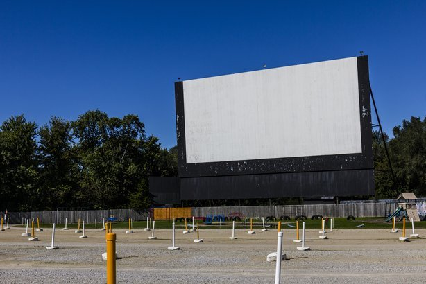 drive-in movie theater with outdoor screen and playground