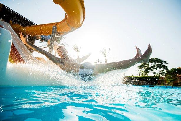 man having fun on water slide