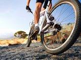 man riding mountain bike on trail