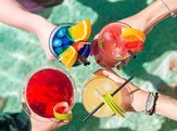 four summer cocktails in four hands at the pool