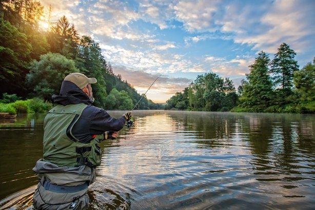 sport fisherman hunting fish