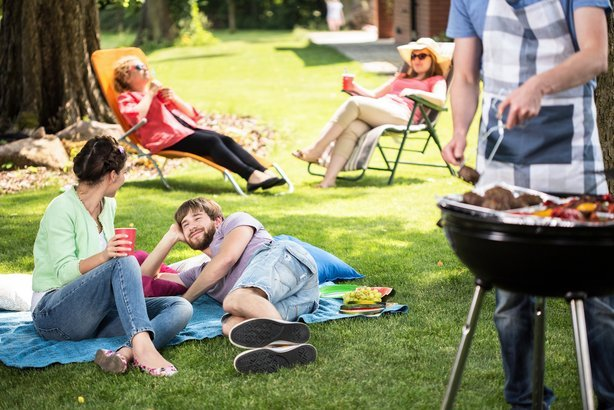 people outside enjoying a cook out
