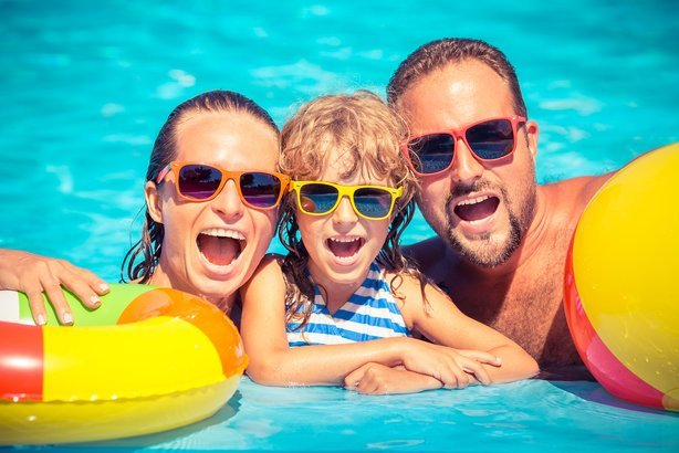 family in the water of a pool