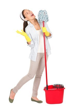 young housewife having fun doing chores with cleaning mop and bucket
