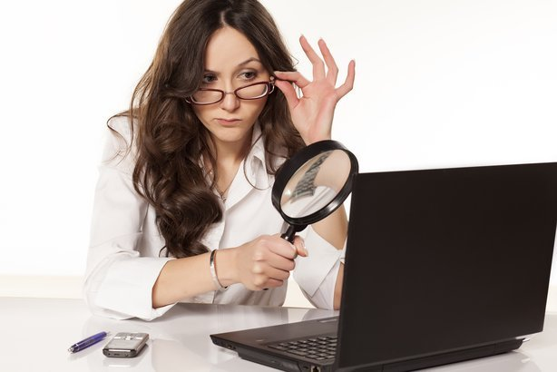 suspicious secretary found something on her laptop with a magnifying glass