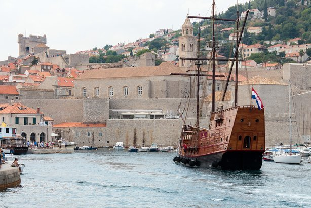 HBO television show Game of Thrones tourist sailing ship entering a harbor of Dubrovnik, Croatia