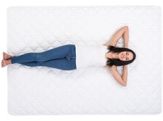 woman is lying on a mattress