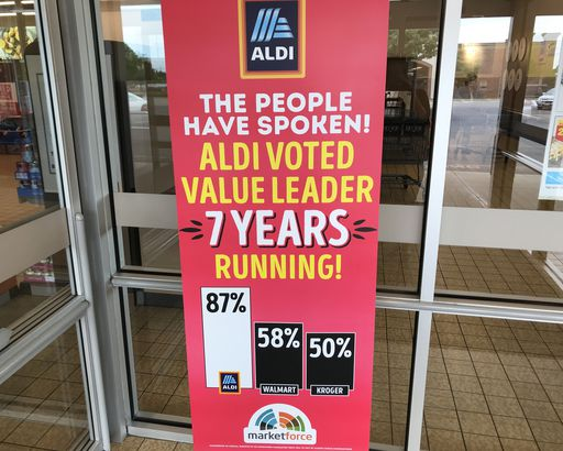 sign in front of Aldi store