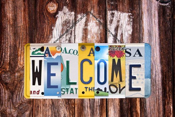 welcome sign written with recycled US license plates