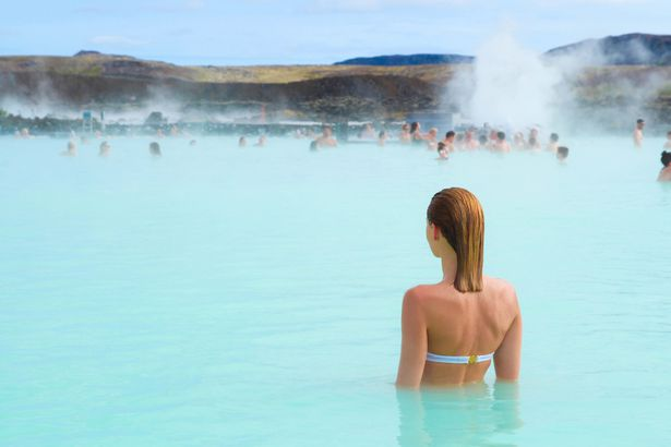 woman in hot spring in iceland