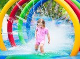 little girl in a splash pad