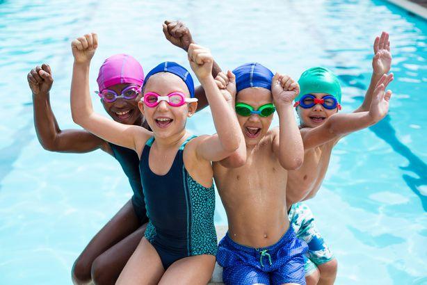 cheerful children enjoying at poolside