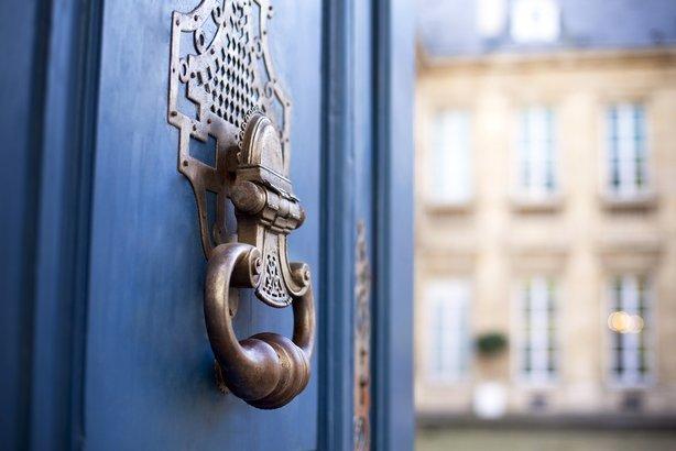 opening door to mansion