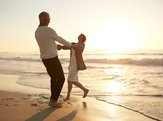 romantic senior couple enjoying a day at the beach