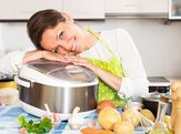 woman hugging her slow cooker in her kitchen