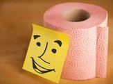 toilet paper roll with smiley face