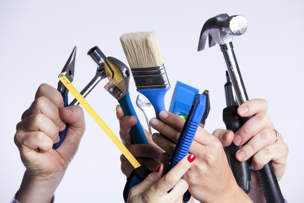 group of people hands with lots of house improvement tools
