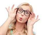 happy young woman or teenage girl glasses making funny fish face
