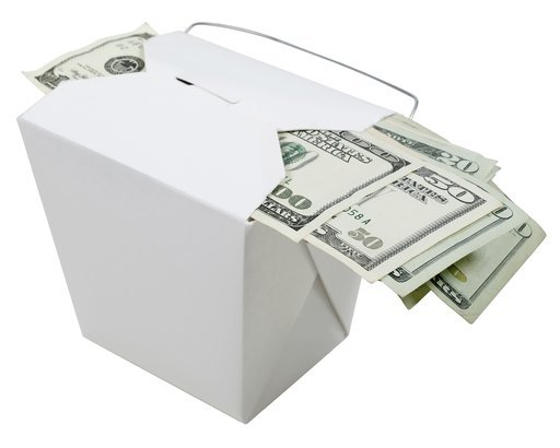 money on top of a takeout container