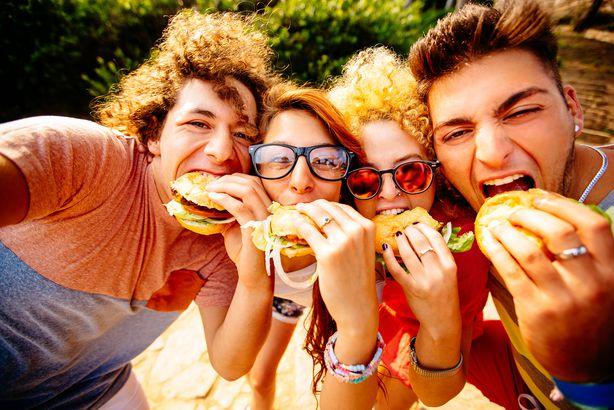 friends taking selfie with hamburgers