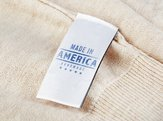 garment label with text 'MADE IN AMERICA HANDMADE'