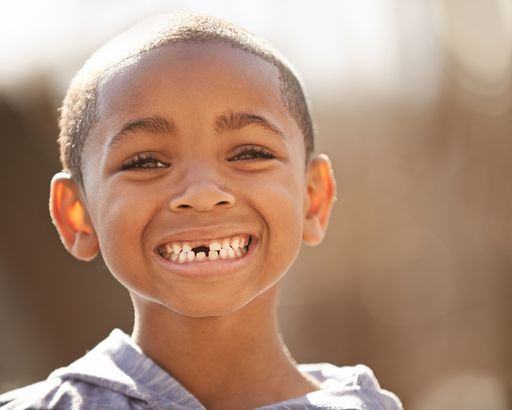 little African American boy with missing tooth