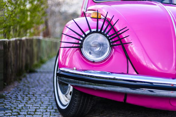 Classic Volkswagen Beetle with eyelashes