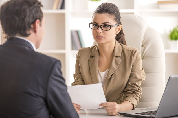 businesswoman interviewing male candidate for job in office