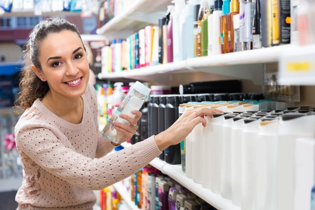 girl choosing hair conditioner at store