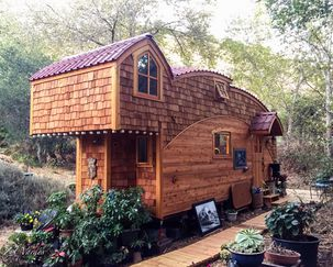 Amazing Tiny Houses You Need to See | Cheapism.com on large log home, natural log home, treated log home, painted log home, flat log home, single log home, smooth log home, restored log home, small log home, standard log home, square log home, solid log home, plain log home,