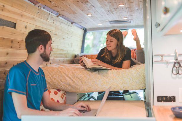 happy couple in a tiny van home