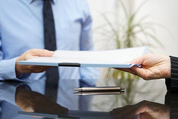 businessman is passing signed agreement to client