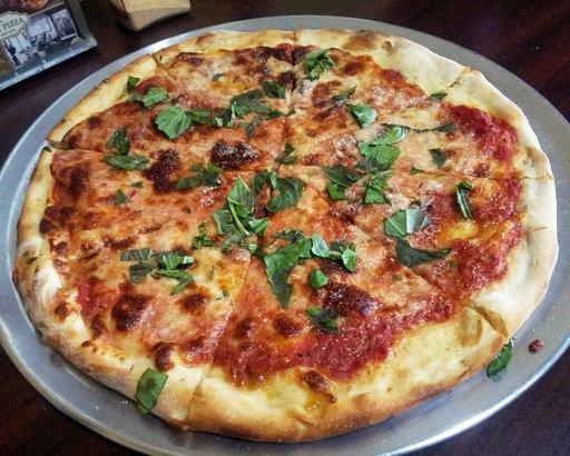 plain cheese round pizza at Di Fara in Brooklyn, NY