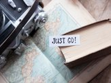 "text ""Just go"" book, map and retro camera"