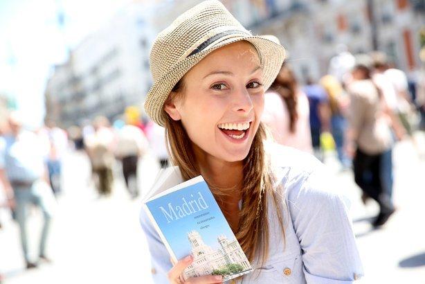 happy girl visiting madrid