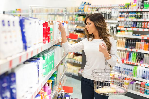 woman shopping for skin lotion in supermarket