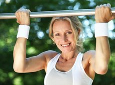beautiful middle-aged woman doing a pull-up